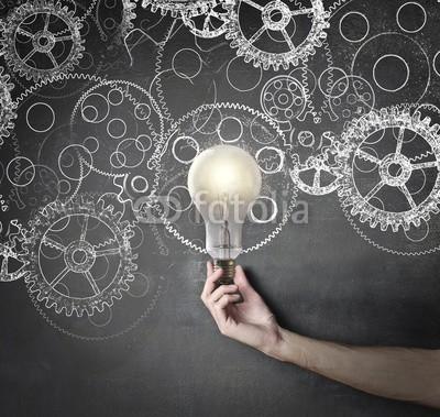 olly, gears and innovative ideas (ideen, mann, hand, konzept, work, business, schule, zahnrad, remis, studenten, glühbirne, licht, schultafel, schultafel, hintergrund, erfolg, karriere, objekt, oberfläche, textur, schreiben, kreativ, kaukasier, weiß, person, schwarz, farbe, angestrahl)