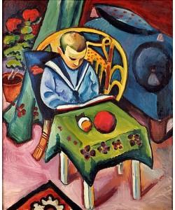 August Macke, Junge mit Buch und Spielsachen.