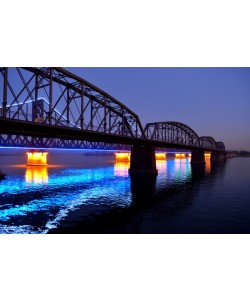Hady Khandani, ILLUMINATED SINO-KOREAN FRIENDSHIP BRIDGE OVER YALU RIVER BETWEEN CHINA AND NORTH KOREA - DANDONG - BLUE