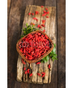 pilipphoto, Goji berries in the basket on the rustic table