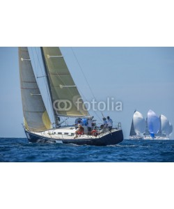 Pavel, Racing boat with carbon sails sailing up wind