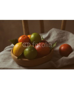 Africa Studio, Composition of different citrus fruits in bowl on napkin, closeup
