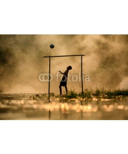 sutiporn, Soccer The boy silhouette  playing football in the river Thailand and Laos