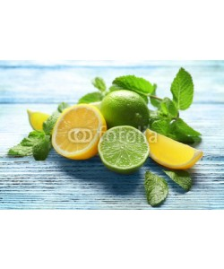 Africa Studio, Composition with citrus fruits and mint on wooden background