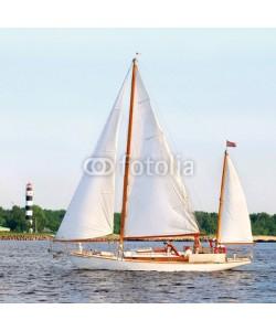 Aleksey Stemmer, white sail yacht sailing. Riga, Latvia