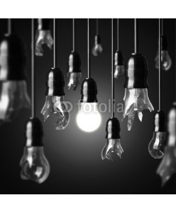 chones, idea concept with broken bulbs and one glowing bulb