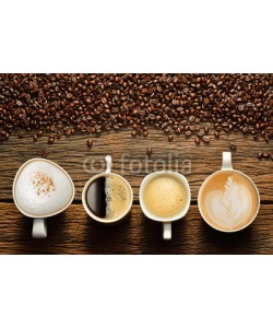 amenic181, Variety of cups of coffee and coffee beans on old wooden table
