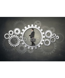 Coloures-pic, Businessman walking in wheel
