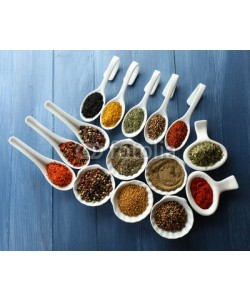 Africa Studio, Different kinds of spices in ceramics spoons, close-up,