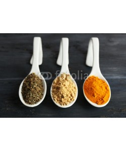 Africa Studio, Different kinds of spices in spoons on wooden background