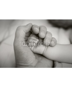 dechevm, holding a hand of the newborn child in Black and White
