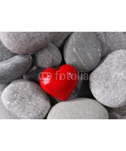 Africa Studio, Red heard over pebbles background