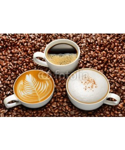 amenic181, Variety of cups of coffee on coffee beans background