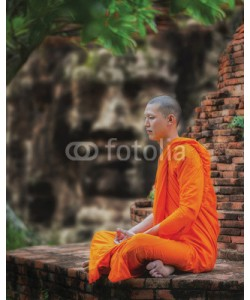 anekoho, Angkor Wat monk. Ta Prohm Khmer ancient Buddhist temple in jungle forest. Famous landmark, place of worship and popular tourist travel destination in Asia