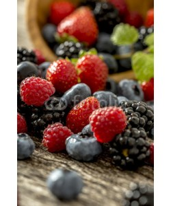 Gajus, Raspberries, strawberries, blackberries and blueberries scatteri