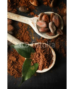 Africa Studio, Spoon with aromatic cocoa powder and green leaf on scratched wooden background, close up