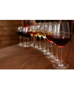 Africa Studio, Many glasses of different wine in a row on bar counter