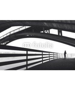 frankie's, Man standing under bridge arch