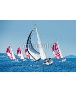 Pavel, Sailing boat with black and white spinnaker catching up sailing boat on horizon