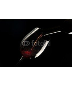 MAURO, glass with red wine on black background