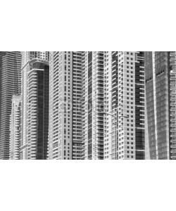 MaciejBledowski, Black and white picture of modern buildings facades.