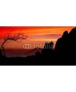 Cara-Foto, Dramatischer Sonnenuntergang über Felslandschaft