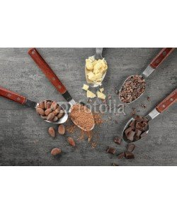 Africa Studio, Spoons with different cocoa products on grey background