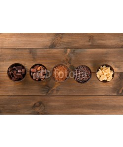 Africa Studio, Bowls with cocoa products on wooden background