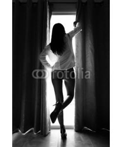 dima266f, Silhouette of beautiful slim woman against the window