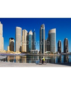 Sophie James, A cyclist cycles the Marina walk, Dubai Marina and JBR