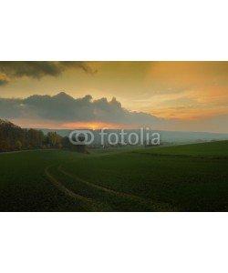 Foto Graf, Misty sunset,golden sunbeam shine through the Deister.