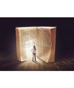 kevron2001, Woman looking at large book