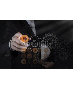 everythingpossible, businessman hand pointing to gear to success