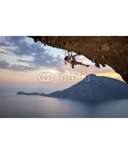 Andrey Bandurenko, Young female rock climber at sunset, Kalymnos Island, Greece