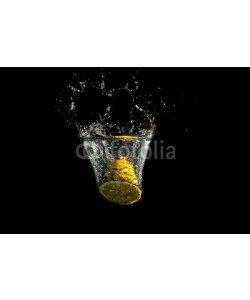 Gajus, Halved fresh lemon splashing into clean water