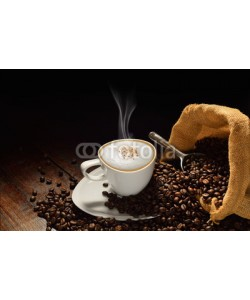 amenic181, Cup of coffee with smoke and coffee beans on old wooden table