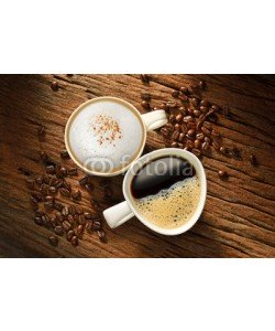 amenic181, Two cups of coffee and coffee beans on old wooden table