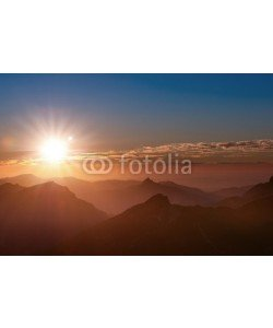 a2l, sunset mood on top of tirol mountain with peaks clouds and sun