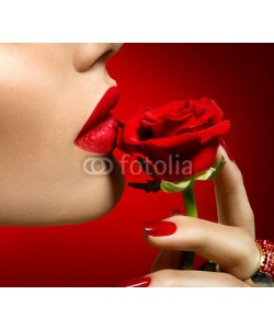 Subbotina Anna, Beautiful model woman kissing red rose flower. Sexy red lips