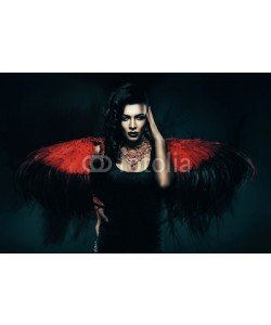alexbutscom, transvestite with red wings behind