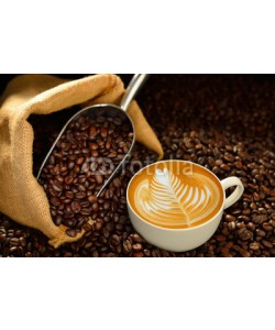 amenic181, Cup of coffee latte and coffee beans on wooden table