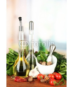 Africa Studio, Composition of mortar, bottles with olive oil and vinegar, and