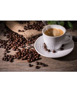 Alexander Raths, Cup of coffee and coffee beans on wooden background