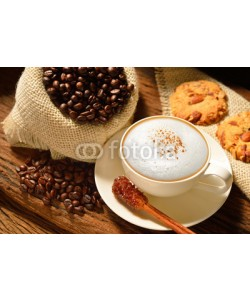 amenic181, A cup of cappuccino with coffee beans and cookies