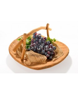 amenic181, Grapes in wooden basket isolated on white