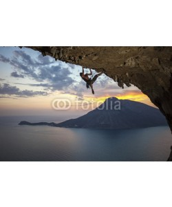 Andrey Bandurenko, Male rock climber at sunset. Kalymnos Island, Greece