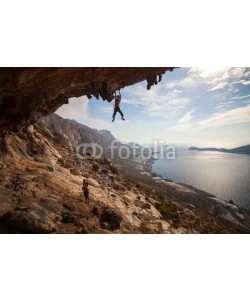 Andrey Bandurenko, Rock climber climbing at the rock , Kalymnos Island, Greece