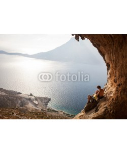 Andrey Bandurenko, Young couple of rock climbers having a rest, Kalymnos, Greece