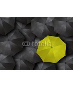 chones, concept for leadership with many blacks and yellow umbrella