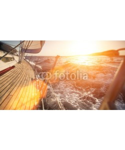 De Visu, Yacht sailing during sunset.